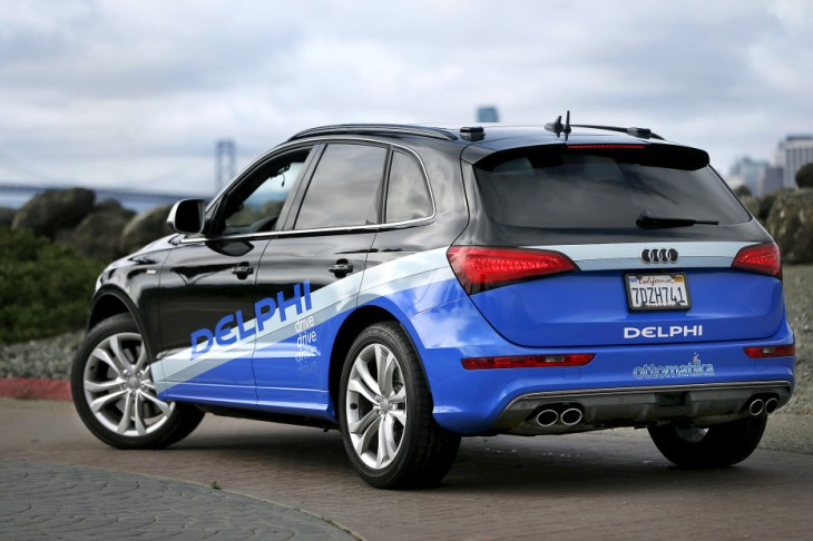 22 Mar 2015, San Francisco, California, USA --- An autonomous car from Delphi drives on Treasure Island in preparation for a cross-country trip from San Francisco to New York City in San Francisco, California March 22, 2015. The self-driving vehicle, modified from a production Audi SQ5 crossover, will travel 3,500 miles in a demonstration of the automotive parts manufacturer's capabilities while collecting over two terabytes of data.The vehicle is expected to arrive in time for the New York International Auto Show which begins on April 3. REUTERS/Stephen Lam --- Image by © STEPHEN LAM/Reuters/Corbis